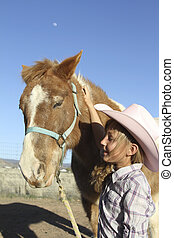 Young Cowgirl and Pony