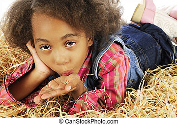Young Cowgirl Blowing a Kiss