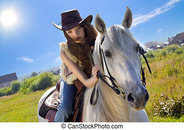 young cowgirl gallop on white horse