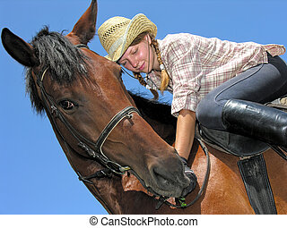 young cowgirl horseback riding