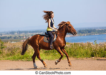 young cowgirl on brown horse