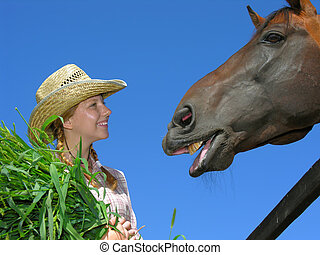 young cowgirl with horse