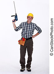 young craftsman holding a drill