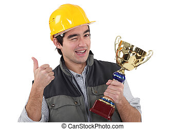 young craftsman winking holding trophy