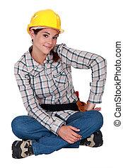 young craftswoman sitting cross-legged