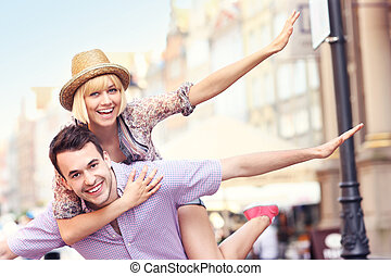 Young crazy couple having fun in the city - A picture of a...