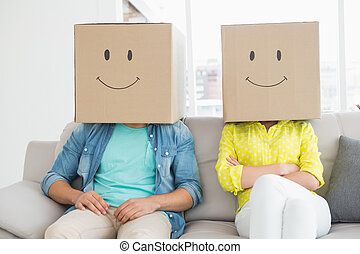 Young creative team wearing boxes on head in creative office