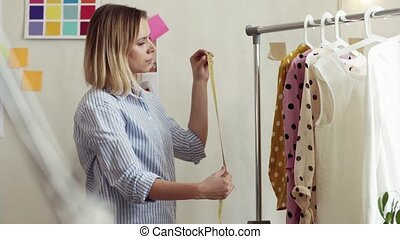 Young creative woman in a studio, startup business. - Young...