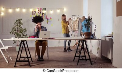 Young creative women in a studio, startup business. - Young...