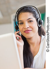 Young customer service wearing headset