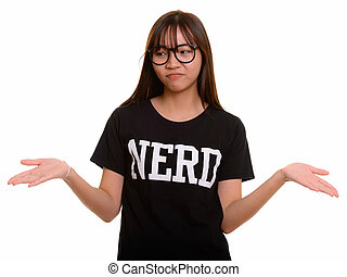 Young cute Asian nerd teenage girl shrugging shoulders