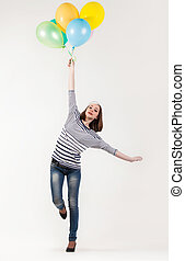 Young cute brunette girl in parisian style with ballons