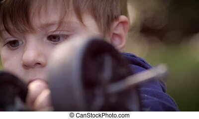 Young cute child intensely focused and playing with his toys