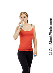 young cute fitness woman drinking water on white background