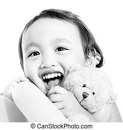 Young Cute Girl Hugging A Teddy Bear