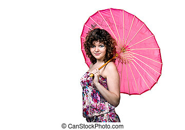 Young cute girl in a dress with pink umbrella