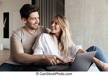 Young cute happy loving couple in home