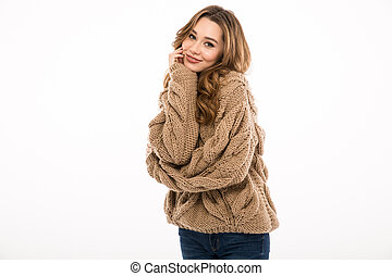 Young cute lady dressed in warm sweater