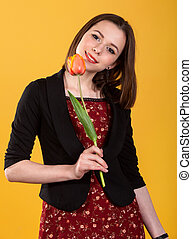 Young cute teen brunette girl with tulip