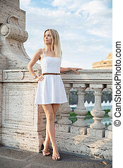 Young cute woman posing on a bridge
