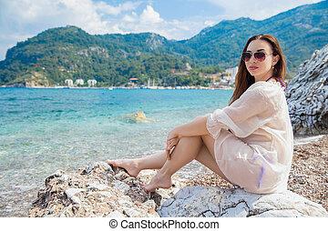 Young cute woman posing sitting