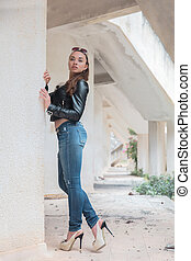 Young cute woman posing standing