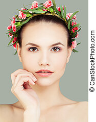Young Cute Woman Spa Model with Healthy Skin and Flowers