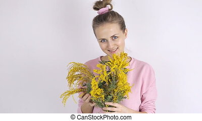 Young cute woman with yellow mimosa flowers - Young cute...