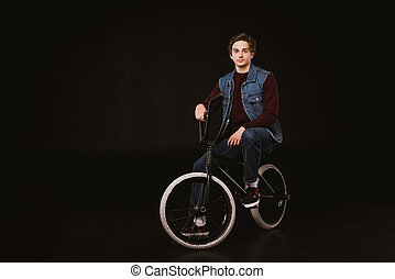 young cyclist with bmx bicycle