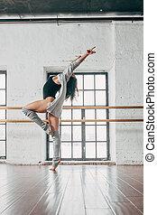 Young dancer dancing in studio