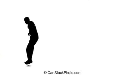 Young dancer man dancing breakdance moves, white, silhouette, slow motion