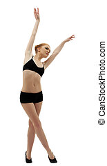 young dancer posing in black top isolated