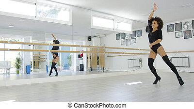 Young dancer practicing modern dancing