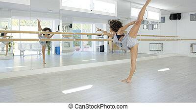 Young dancer practising in a dance studio
