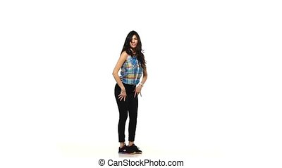Young dancing lady style woman in plaid shirt on white background, slow motion
