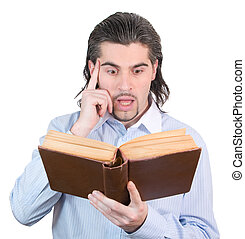 Young dark haired caucasian man in light blue shirt reads...