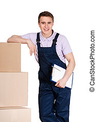 Young delivery man in overalls with boxes
