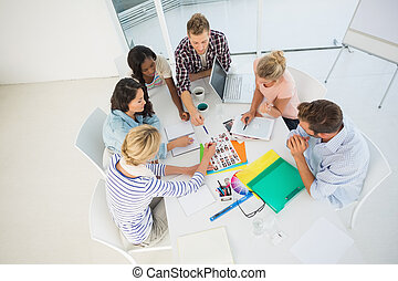 Young design team brainstorming together in creative office