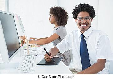 Young designer smiling at camera at
