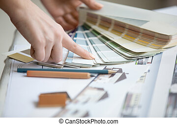 Young designer working with color palette - Creative people...