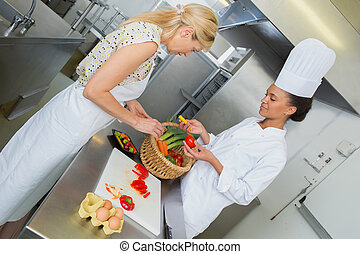 young dietician working in the kitchen
