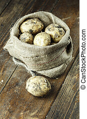 dirty potatoes in a bag
