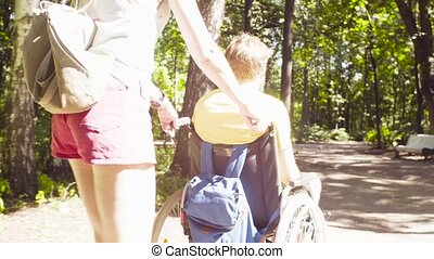 Young disable man in the park with his wife