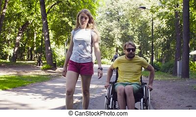 Young disable man with his wife talking and smiling