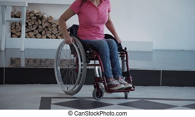 Woman in comfort wheelchair spending day at home - Young...