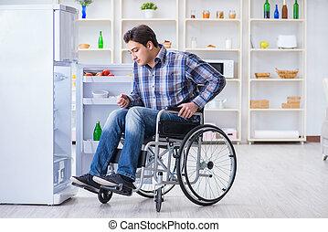 Young disabled injured man opening the fridge door