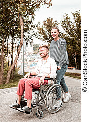 Young disabled man feeling confident while spending time with girlfriend