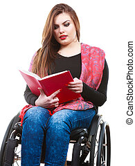 Young disabled woman in wheelchair with book. - Studying and...