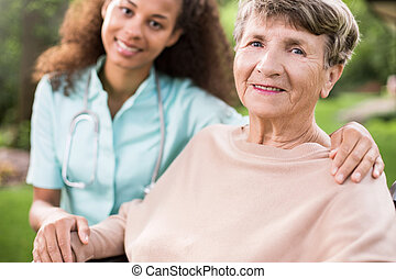 Young doctor and elder woman