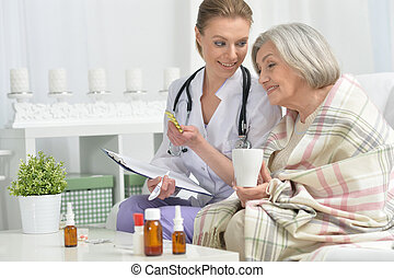 doctor and her senior senior patient